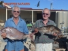 2-men-holding-large-fish
